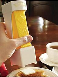 uno scatto di burro taglierina affettatrice - fette w / uno squeeze - funge anche da piatto di burro