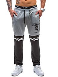 economico -pantaloni chino elasticizzati normali a vita media da uomo, vintage lettera in poliestere / cotone primavera / autunno