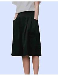 baratos -saias de linha na altura do joelho de uma mulher - cintura alta de cor sólida